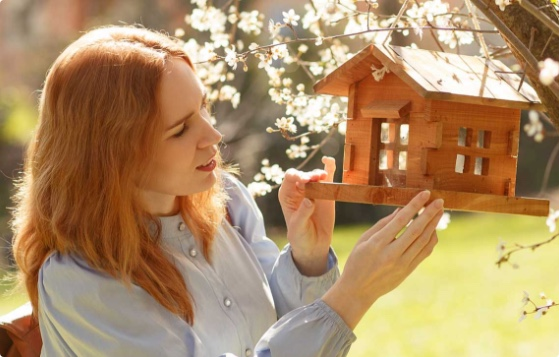 Woman with bird house